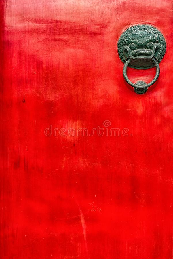Chinese red door with decorative handle. A textured Chinese temple red door with dragon decorative handle stock images