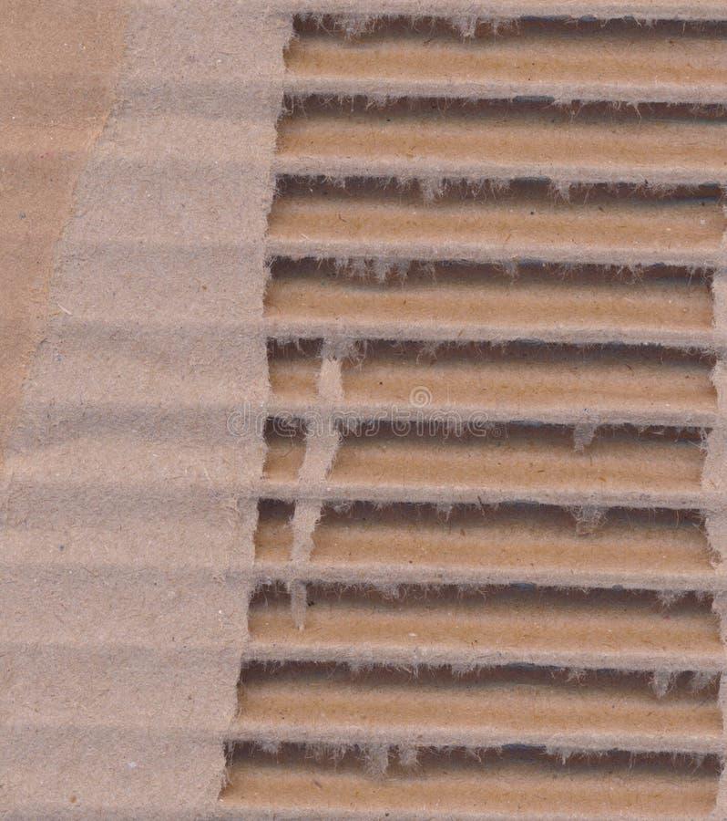 Textured corrugou fundo listrado do papel do cartão fotografia de stock