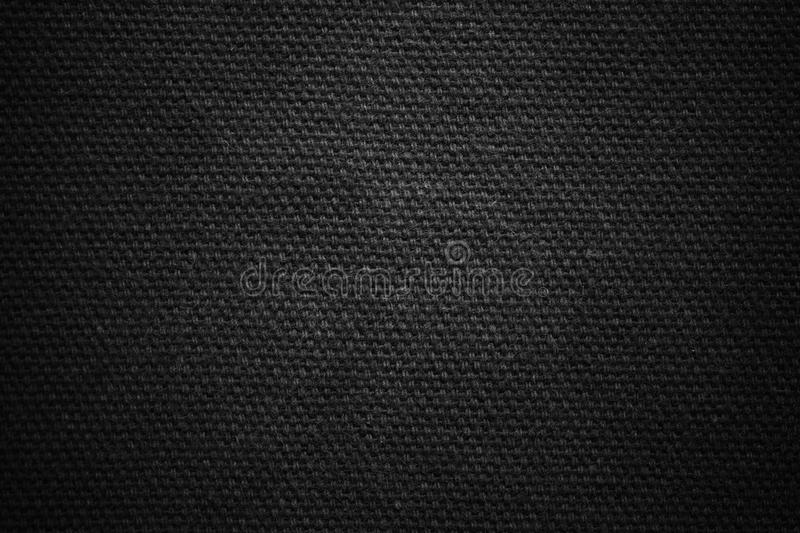 Textured fabric jeans. Dark background texture. Blank for design royalty free stock photos
