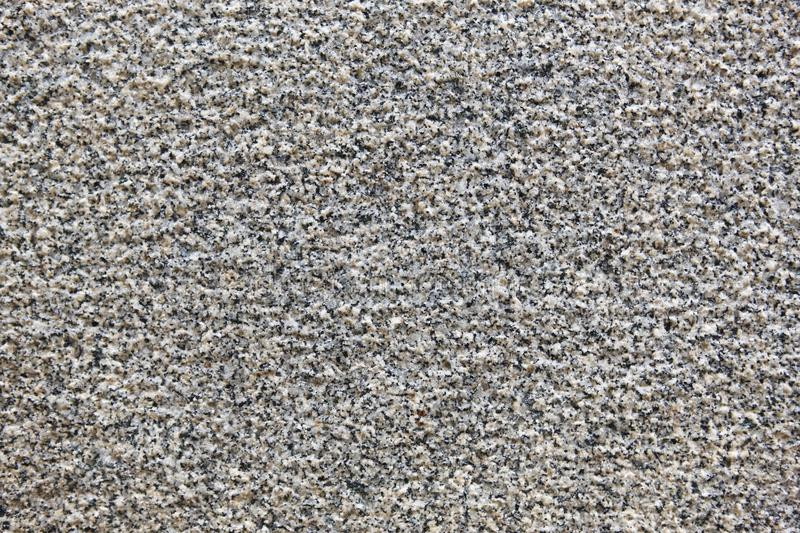 Textured granite surface. Mineral background. Construction royalty free stock photo