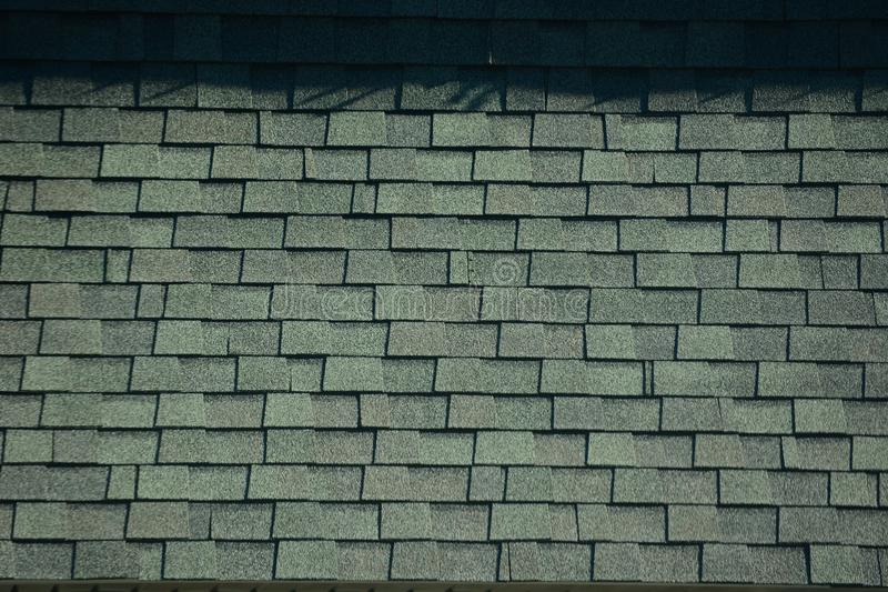 Textured gray roof shingles stock photo