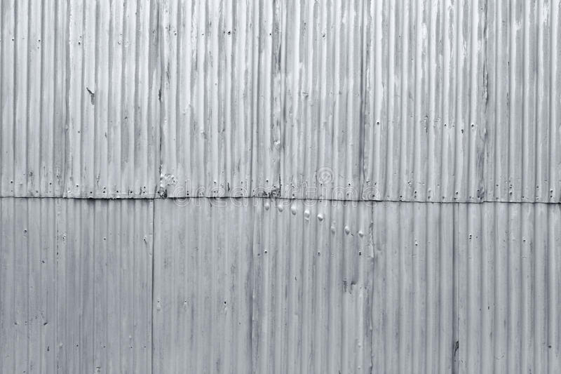 Textured grunge corrugated metal background. Rough grunge textured old corrugated steel background royalty free stock image