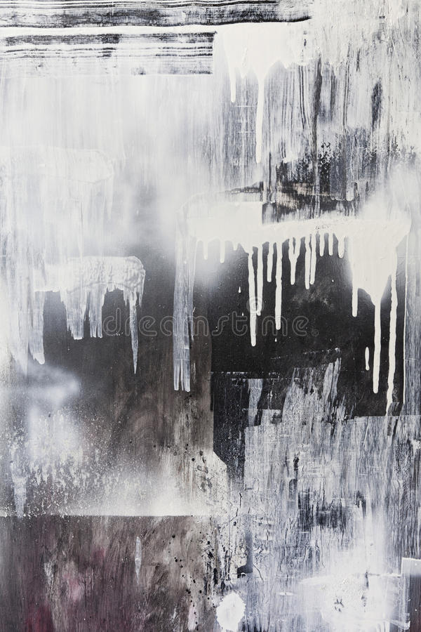 Textured grunge painted background. Rough paint textured black and white dripping spraypaint artwork background royalty free stock images