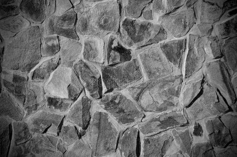 Textured kamienna ściana w czarny i biały obraz royalty free