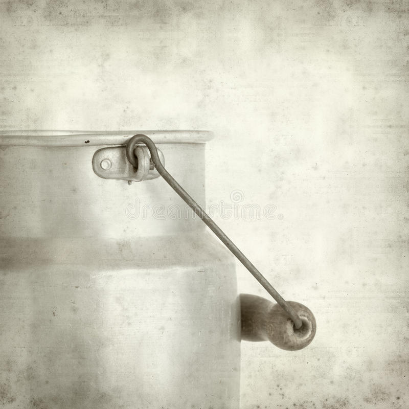 Textured old paper background with. Aluminium milk pail royalty free stock photo