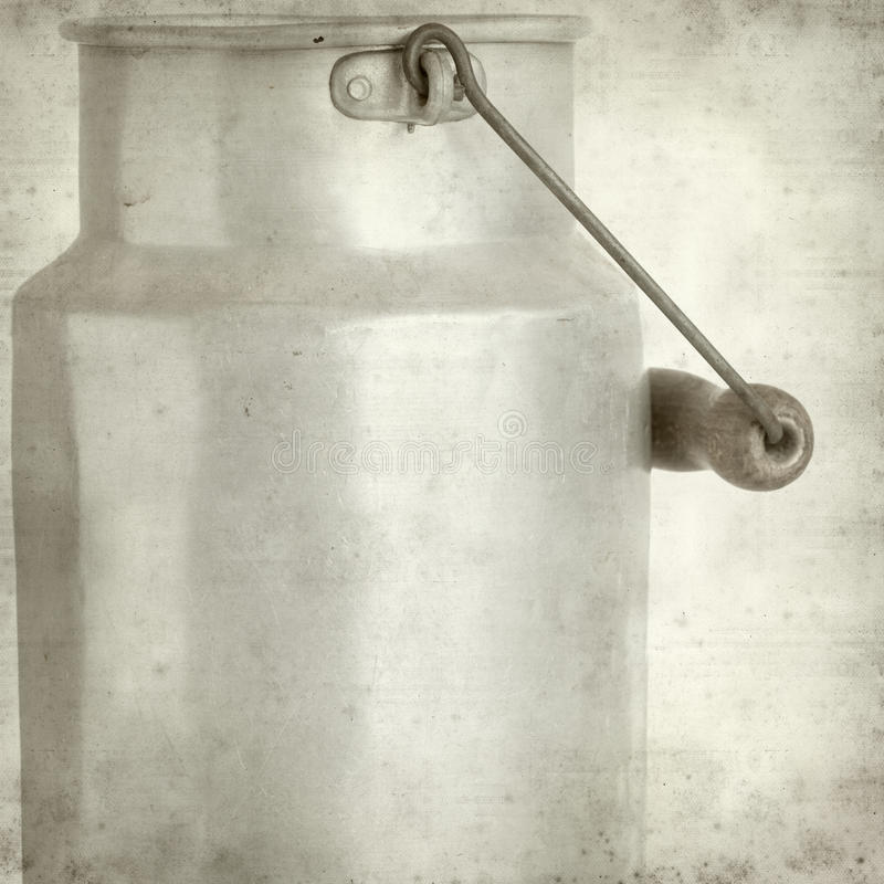 Textured old paper background with. Aluminium milk pail stock image