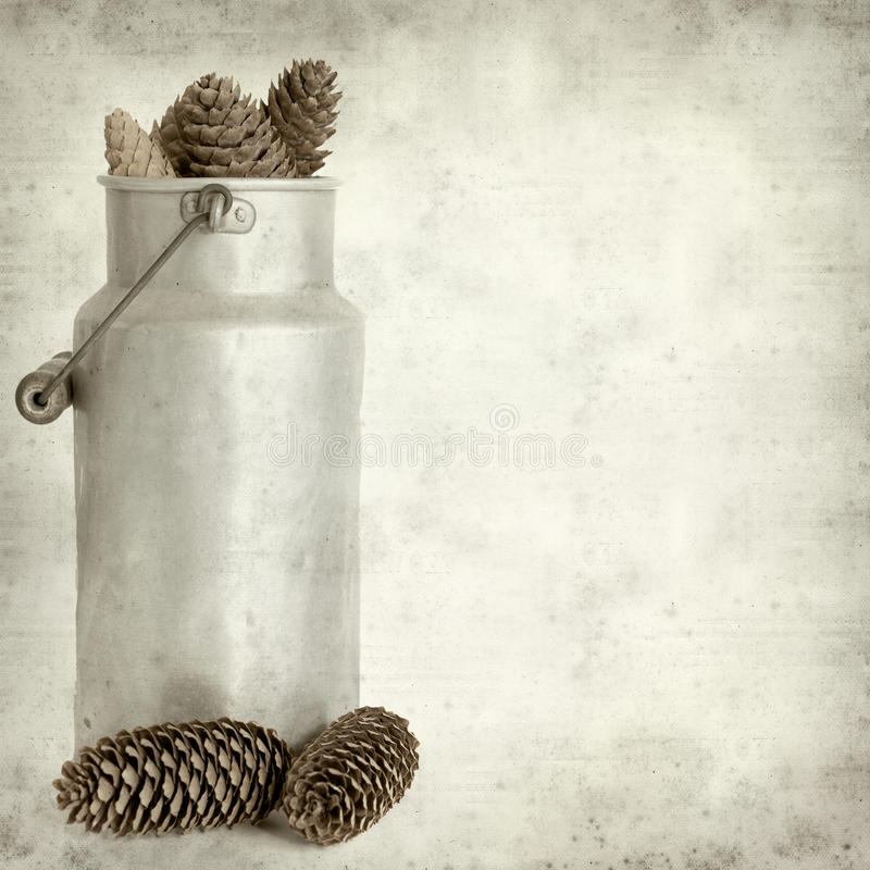Textured old paper background with. Aluminium milk pail stock photography