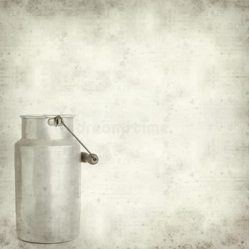 Textured old paper background with. Aluminium milk pail stock photo