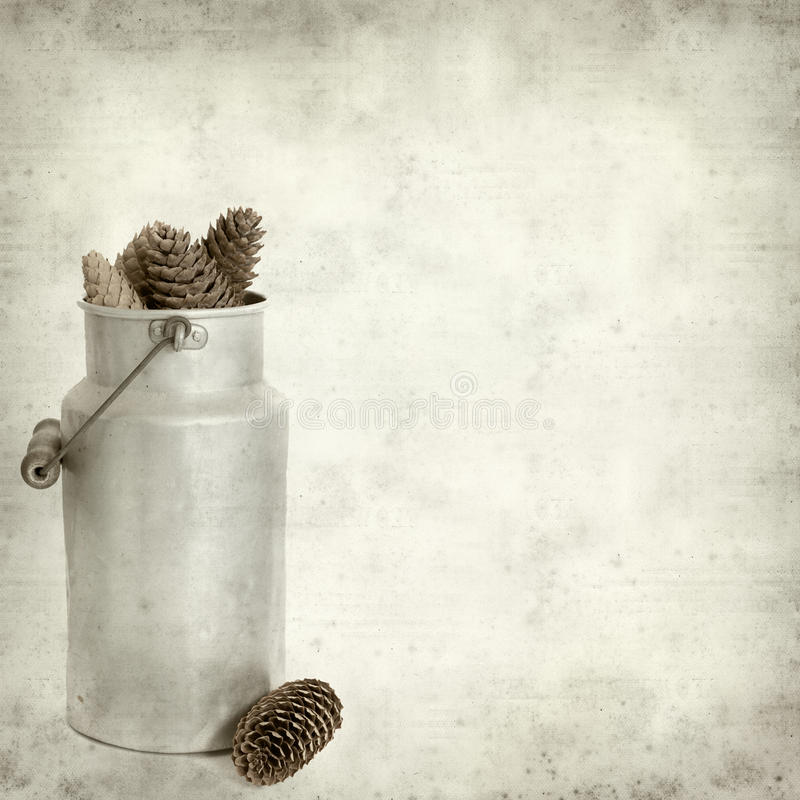 Textured old paper background with. Aluminium milk pail stock photos