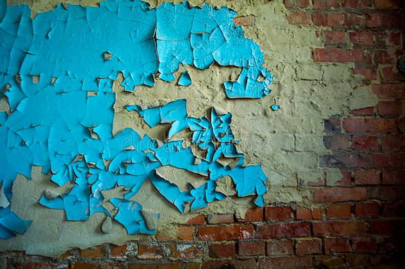 Textured old walls of houses in different colors. Moss-covered peeling paint ruins royalty free stock photos