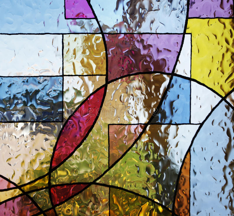 Textured paint on glass. Stained Glass stock images