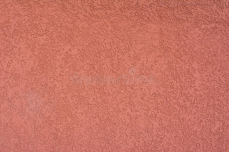 Textured plaster Terra cotta color. Day stock photo