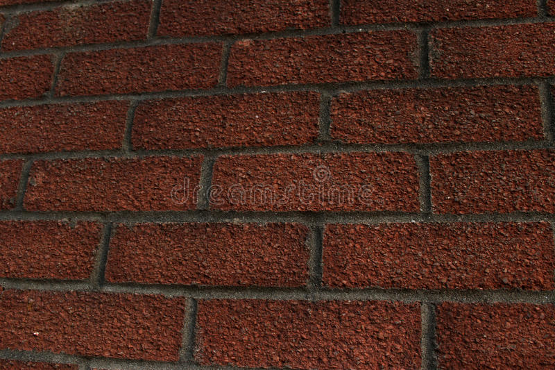 Textured red brick wall. With grey cement join royalty free stock photography