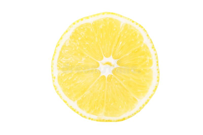 Textured ripe slice of yellow lemon citrus fruit isolated on white background, top view royalty free stock photography