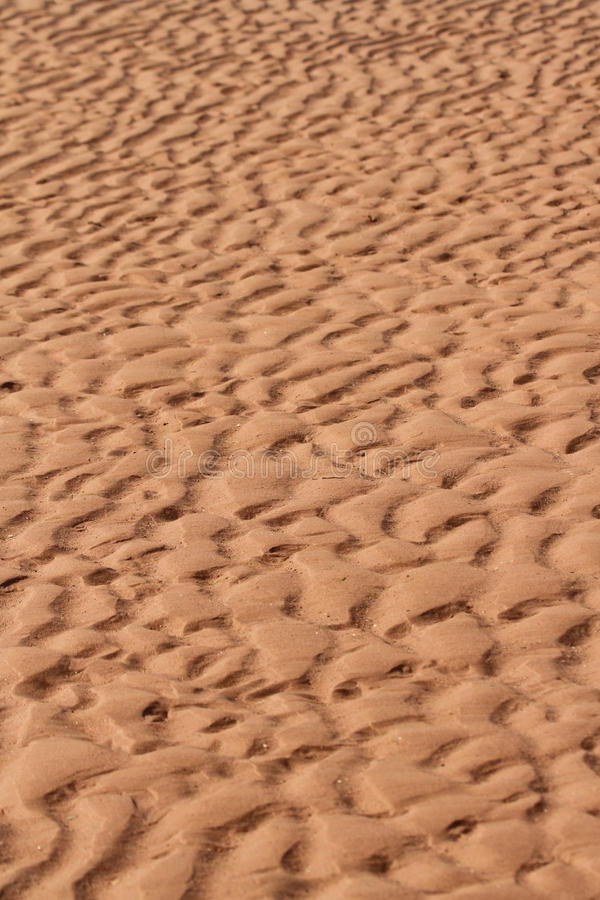 Textured sand. Textured, rippled sand on the beach portrait orientation with copy space stock images