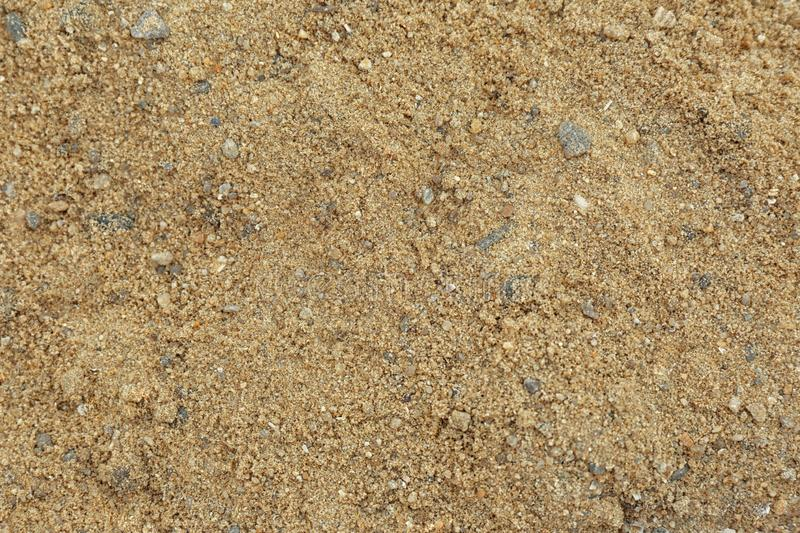 Textured sandy soil surface as background royalty free stock photos