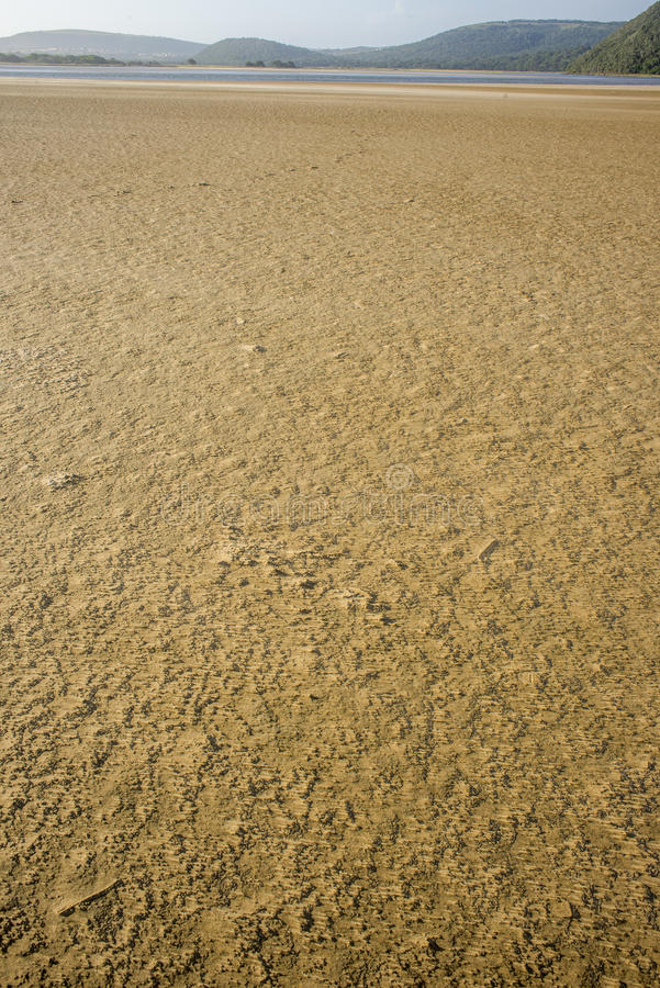 Textured sea sand by river mouth stock photos
