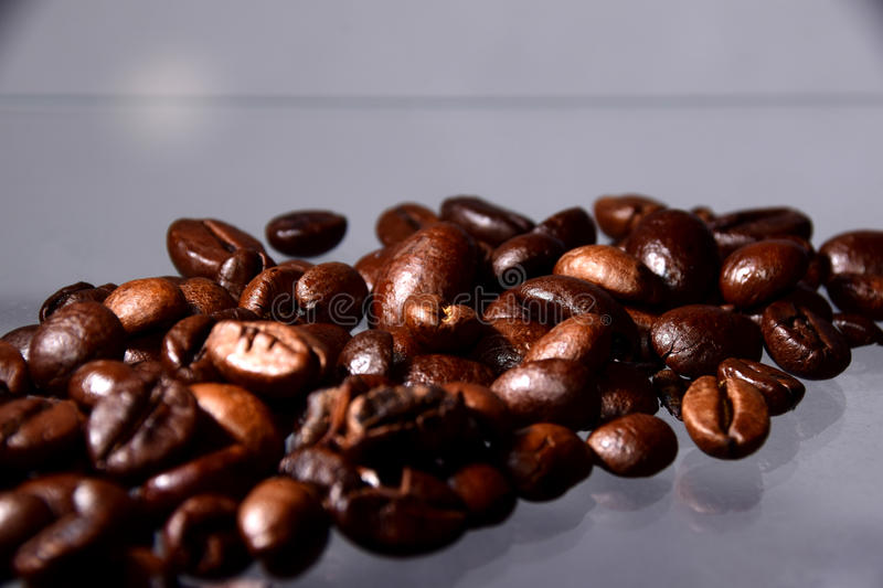 A textured shape made by coffee beans stock photo