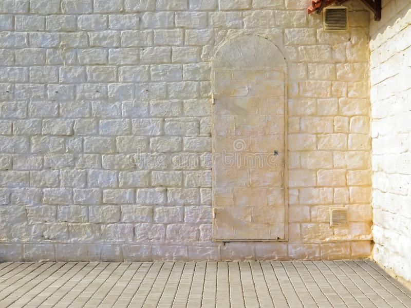 Textured street wall. Facade of the house of a city street Background for model shooting.  stock photos