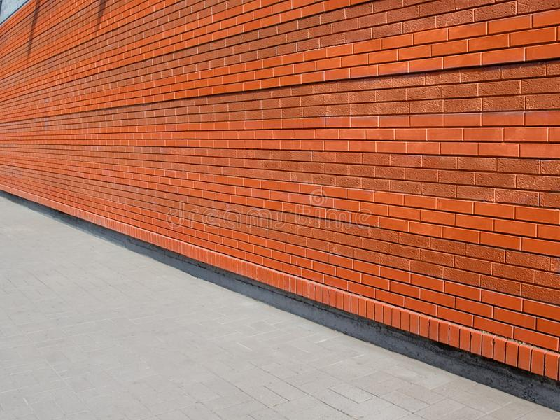 Textured street wall. Facade of the house of a city street Background for model shooting.  stock photography