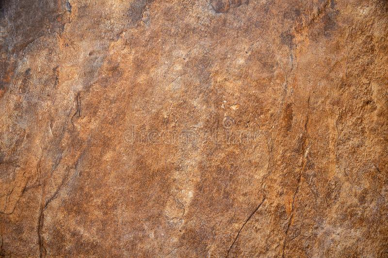 Textured surface of the marble rock with brown tint background royalty free stock photos