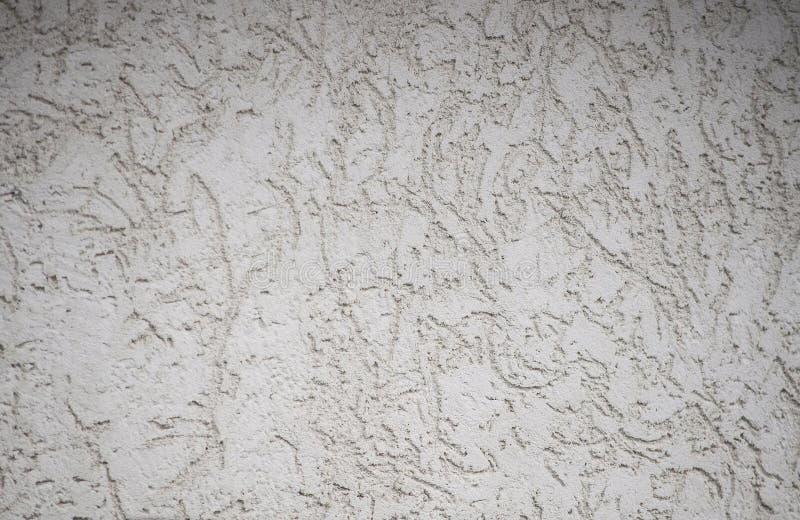 Textured texturerade den gr?a oj?mna v?ggen som en bakgrund med ?der arkivfoto