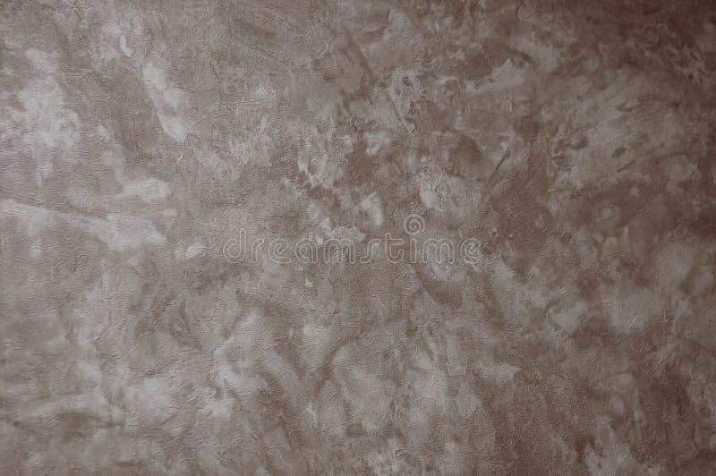 Textured texturerade den gr?a oj?mna v?ggen som en bakgrund med ?der arkivbild
