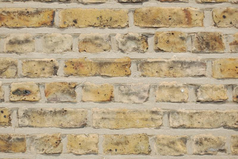 Textured Urban Beige Natural Stone Background, sand wall pattern texture. London 2018. royalty free stock photography