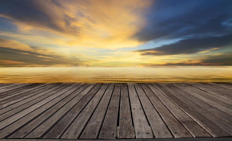 Textured of wood terrace and beautiful dusky sky with free copy space use for background, backdrop to display goods and new stock photography