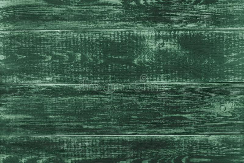 Textured wooden background of the boards shabby chic, rich green stock photo