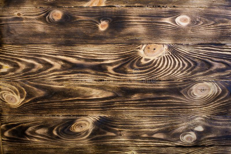 Textured wooden background. A wooden wall made of boards. stock image