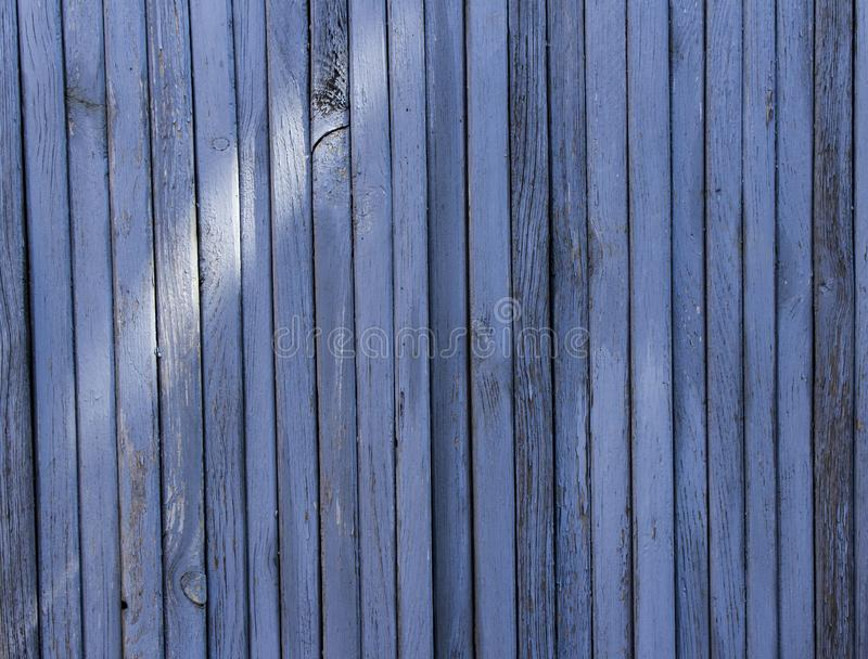 Textured wooden surface of gray-blue color. From thin strips. wooden background stock photography