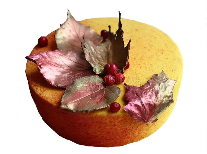 Textured yellow autumn cake with fresh cranberries and chocolate leaves decorations stock photography