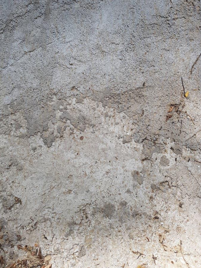 Texturen av betong är grå Textur i stilen av grungegrå färger arkivbild