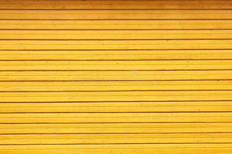 Texturen av den målade gula trädbakgrunden royaltyfria bilder