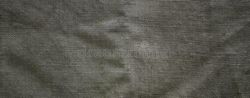 Texturen av en mycket gammal brun säcktorkduk Retro textur med kanfasmaterial Bakgrundsbild med kopieringsutrymme arkivfoto
