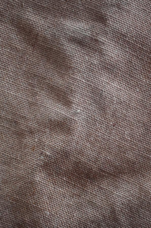 Texturen av en mycket gammal brun säcktorkduk Retro textur med kanfasmaterial Bakgrundsbild med kopieringsutrymme arkivbilder