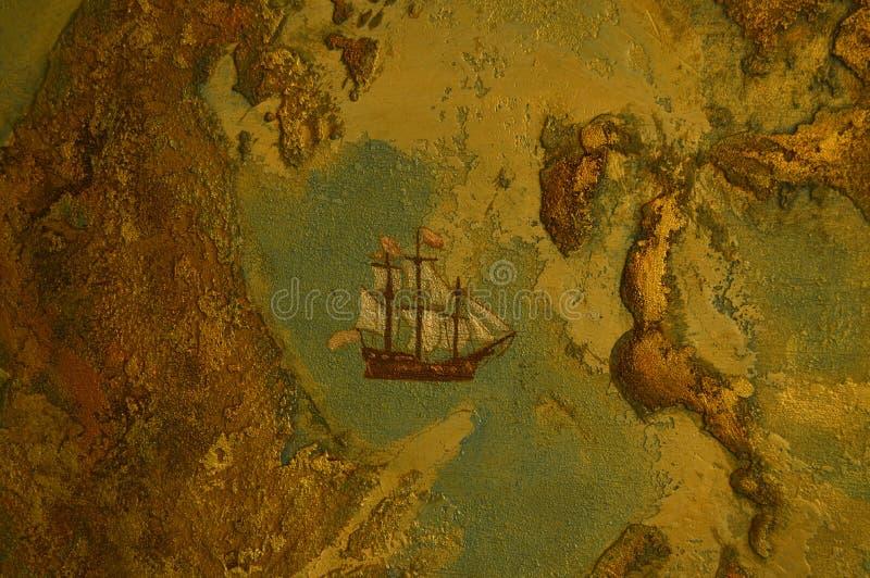 Texturen av kontinenterna av jorden och det målade skeppet arkivbild