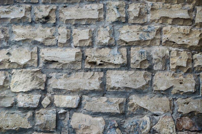 Texturen av murverkväggarna av den klippta stenen arkivfoton