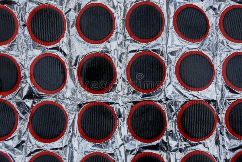 Texturen av svart rubber foder för att reparera cykelkameror royaltyfri bild