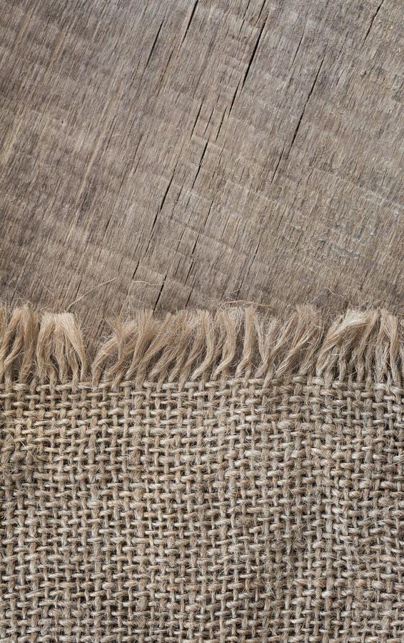 Textureon de serapilheira um fundo de madeira, rústico, Natal Matéria têxtil da tela do teste padrão Fundo da textura fotos de stock royalty free