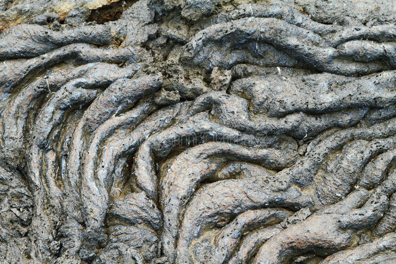 Texturer av svart lava (pahoehoe) i Santiagoön arkivfoton