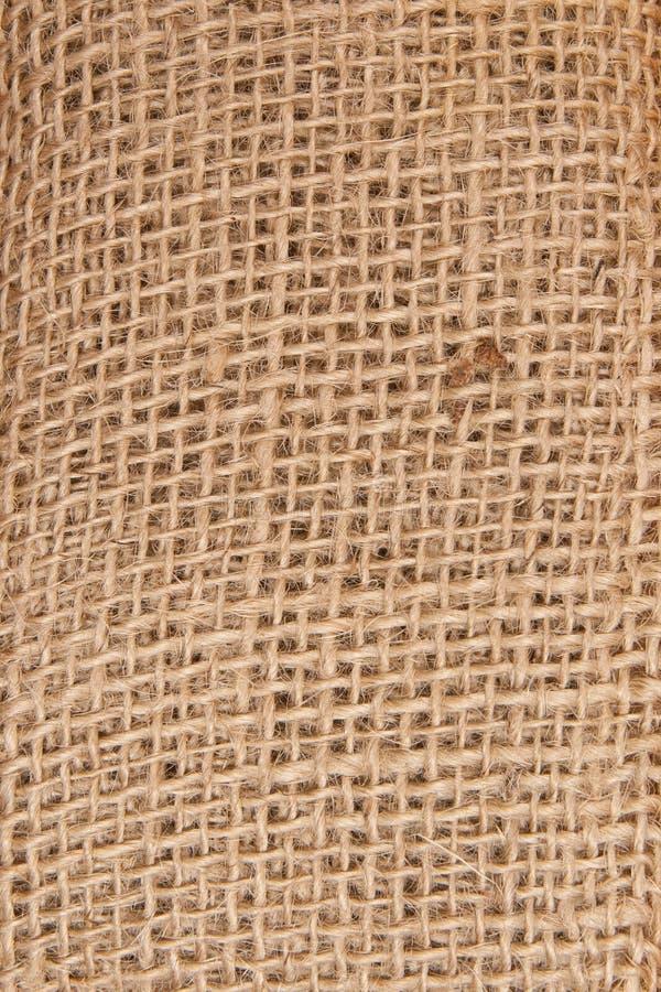 Texturera av gammal sackcloth som scrapbooking arkivfoton