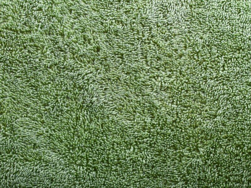 Texturera av grön frotté arkivbild