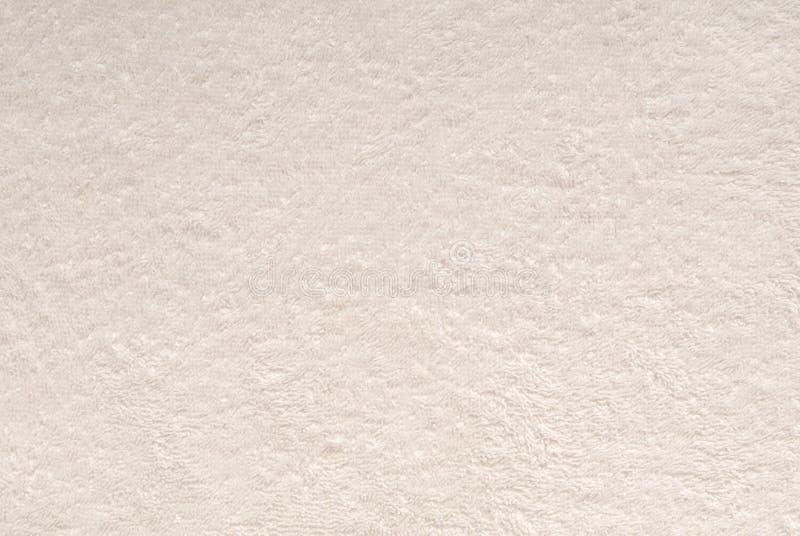 En vit texturerar bakgrund är ut ur frottétyg. arkivfoto