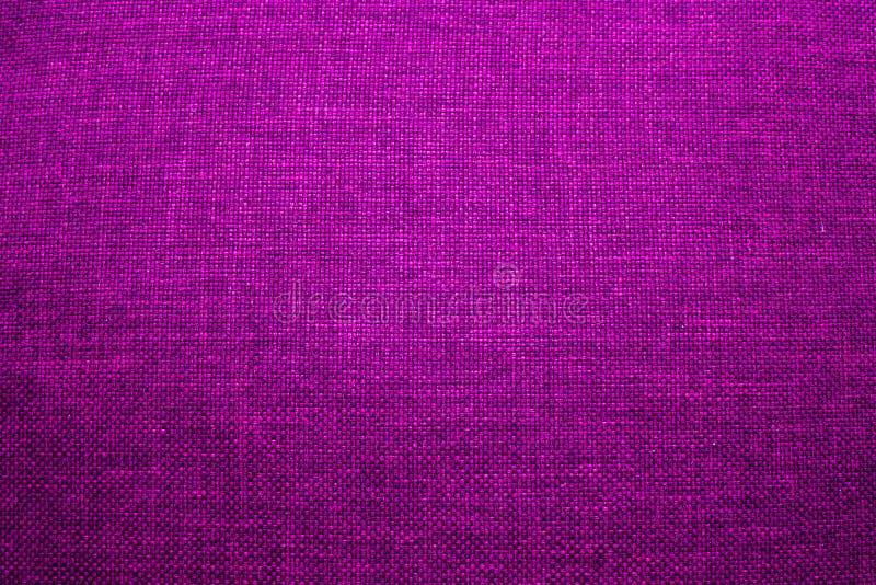 Texturera bakgrund av tyg, textilen som är violett, del av kläder, arkivfoto