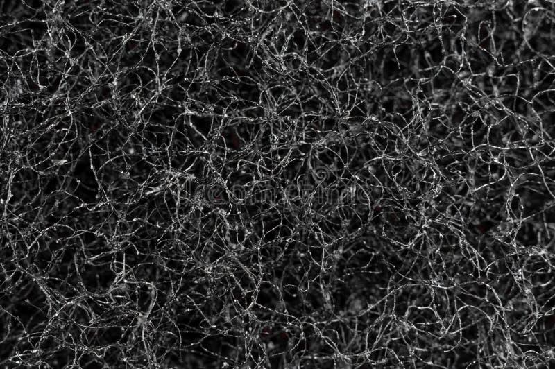 Texturera vriden tråd som är svart med silvercloseupen royaltyfri bild