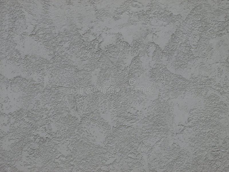 Texturerad betongvägg i grått ljus - arkivfoton