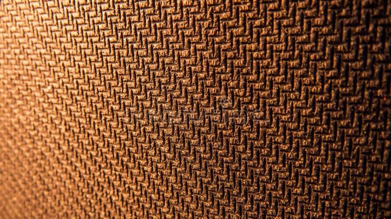 Texturerad gummiyttersida i det varma ljuset av en lampa royaltyfria bilder