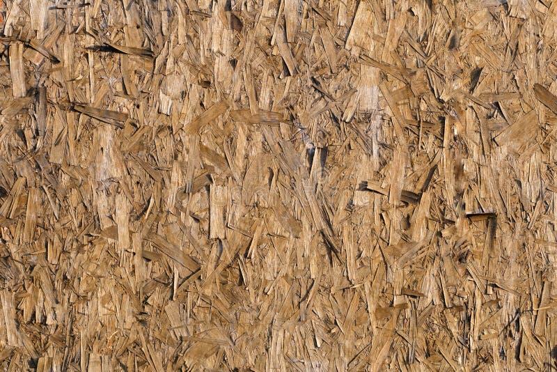 Texturerad träugn pressat ut sågspån arkivbilder